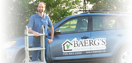 Photo of Dave holding a ladder standing by vehicle.          Vehicle has embedded company branding.